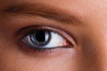 Beautiful blue woman single eye close up