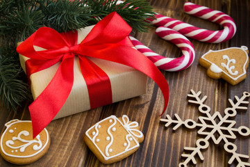 Gift and Christmas composition on the wooden background