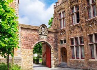 A typical old gate in the streets of Bruges,  Belgium