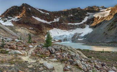 Glacier Recedes into Beautiful Alpine Lake at Dawn