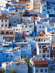 The gorgeous blue streets and blue-washed buildings of Chefchaouen, the moroccan blue city - amazing palette of blue and white buildings