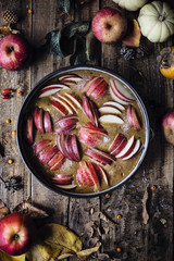 Apple cake in the making on wooden rustic table