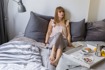 My free morning- A woman spent the morning in bed with breakfast and a book