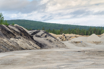 Mining of bitumen in the quarry, northern Norway