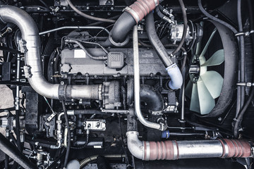 Top view of new modern diesel agricultural  tractor or combine or car motor or harvester engine, toned