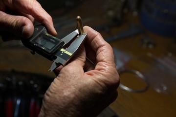 Goldsmith working at desk in workshop