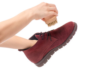 Shoes cleaning brush for shoes in hands