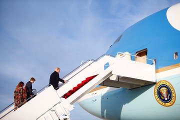 U.S. President Donald Trump, First Lady Melania Trump and their son Barron Trump, board Air Force One as they depart for West Palm Beach, Florida, from Joint Base Andrews