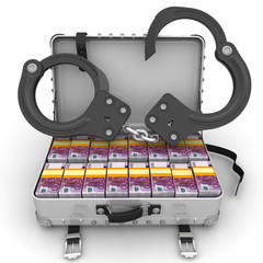 Criminal income. A suitcase filled with packs of European banknotes with handcuffs