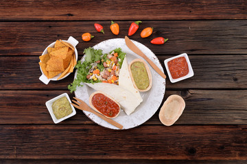 Mexican burrito with tortilla and sauces