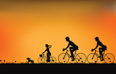Silhouette of family driving bike with beautiful sky at sunset .
