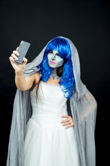 Mobile phone. Girl in makeup makes selfie on mobile phone