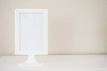 Empty white photo frame on clean background