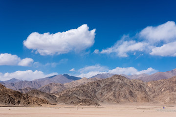 Landscape image of mountains and blue sky background in Ladakh , India