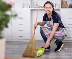 Girl sweeping garbage