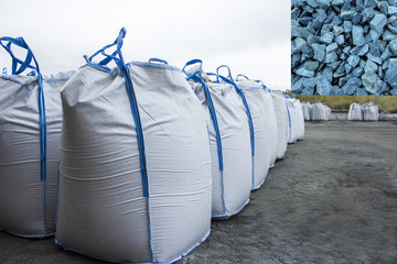 Warehouse large bags of gravel. The outdoor warehouse at the factory or at the port.