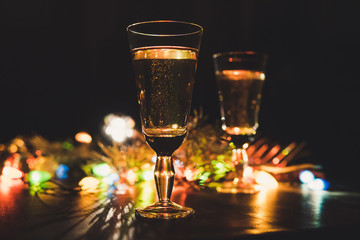 Two sparkling champagne glasses new year celebration christmas