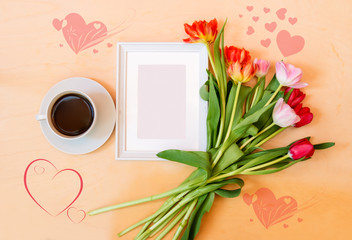 Cup of coffee, picture frame and tlip flowers
