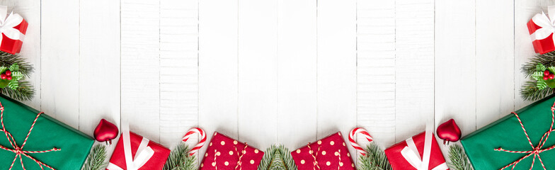 Colorful Christmas gift boxes on white wood banner background border design