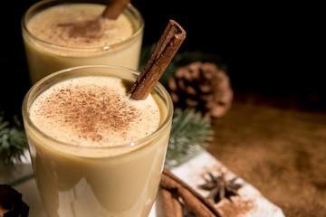 Homemade traditional Christmas eggnog drinks in glasses