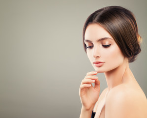 Nice Woman Fashion Model with Natural Makeup on Background with Copy space