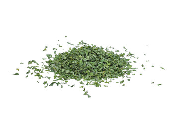 pile of dried parsley leaf or petroselinum crispum isolated on white