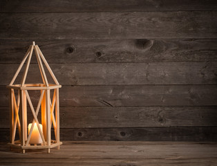 wooden lantern on old rustic background