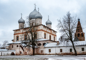 Beautiful white church on the road, winter landscape