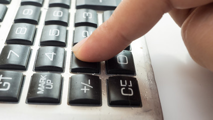 calculator close up with finger