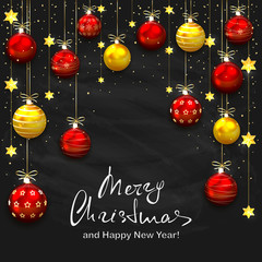 Christmas balls and golden stars on black chalkboard background