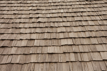 Natural pine wood panels from a wooden roof of a mountain stable