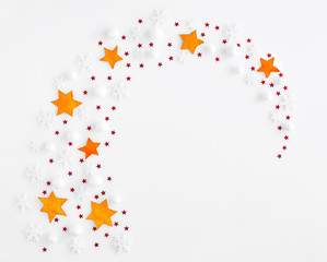 Stars and snowflakes on a white background. Christmas, winter, new year concept. Top view.