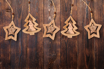 Christmas tree and star with a place for your text on a dark brown background