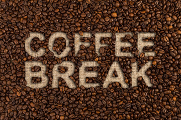 Coffee break concept written on beans