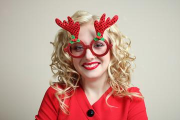 girl in red Christmas glasses