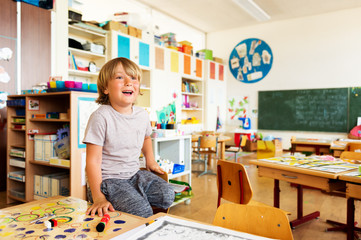 Cute little boy working in classroom, education, back to school concept
