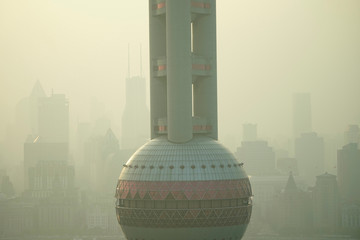 The Oriental Pearl TV Tower is seen in smog during a polluted day in Shanghai