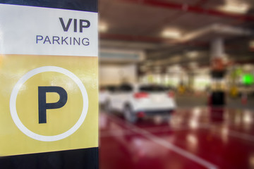 parking spaces for important people. VIP Car parking garage underground interior in supermarket