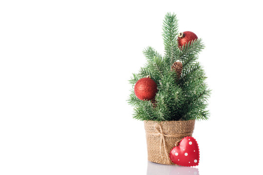 Christmas tree with heart isolated on white