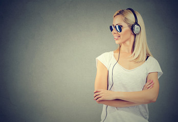 Happy woman listening to music with headphones