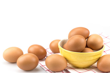 Eggs in mini yellow bowl , isolated on white background