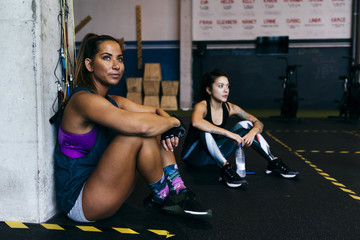 Sportswomen resting after workout
