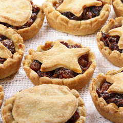 Traditional homemade fruit mince pies on white.