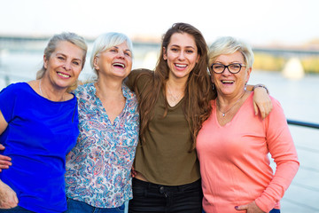 Group of women smiling outdoors