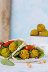 Baked falafel and fresh vegetables in pita bread. Vegan dietary healthy food concept.
