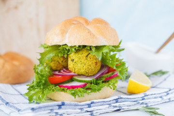 Vegan falafel burger with vegetables.