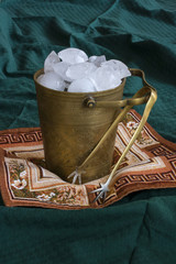 Vintage Ice Bucket On A Green Fabric Background