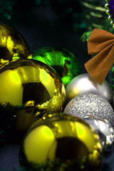 Blue and gold christmas balls on a wooden background.