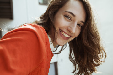 Portrait of smiling young woman on balcony
