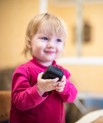 mobile phone in the hands of little girls